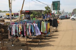Displayed wares of a second-hand clothes trader displayed along the main Karen roadway